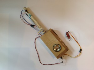A Javanese rebab built out of a cardboard box and various cables.